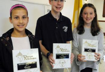 Seventh-grade winners of the spelling bee are, from left: champion Ella Laski, St. Michael the Archangel School; Christian Fragassi, St. Joseph the Worker School, Orefield, second place; and Julia Pohl, Our Lady of Perpetual Help School, Bethlehem, third place.