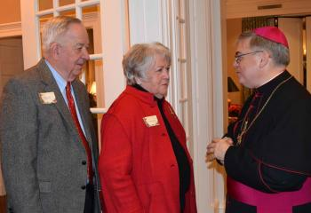 The Honorable William and Maureen Platt, left meet Bishop Alfred Schlert.