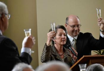 Randy and Paul Waterman, co-chairpersons of the Building Campaign, make a toast celebrating the completion of the new $2.2 million center.