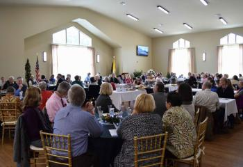 Parishioners enjoy brunch in the new parish hall.