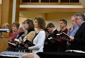 The parish choir sings a hymn during the Mass.