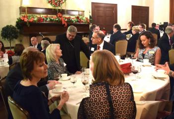 Bishop Alfred Schlert greets Legatus members and guests after dinner.