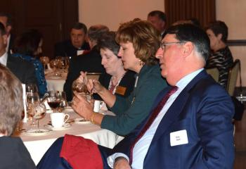 Guests listen to Bishop Alfred Schlert address the group as the evening's featured speaker.