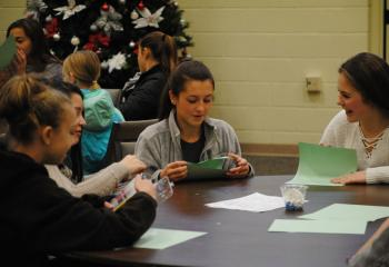 Creating cards for prisoners are, from left, Madeline Sierzega, Meredith Steirer, Andrea Monklewicz and Emma Lincoln. (Photo by Tara Connolly)