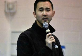 Paul Kim discusses faith, hope and love at the confirmation rally. (Photo by John Simitz)
