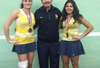 Girls' tennis District XI AA Doubles champions Logan Lencheski, left and Emma Anmolsingh of Notre Dame High School flank coach Tom D'Angelo. (Photo courtesy of Cheryl Fenton)
