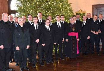 Bishop Schlert, center, celebrates Christmas with seminarians and their pastors along with diocesan officials at Lehigh Country Club.
