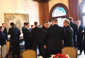 Diocesan seminarians, candidates and priests mingle during the luncheon.