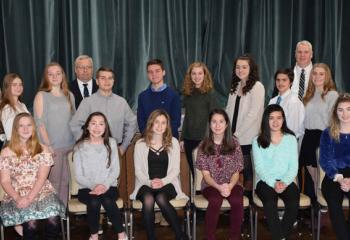"Winners in the ""Stand Up for Life"" essay contest and Diocesan officials are, from left: front, Chloe Palm-Rittle; Leah Wishard; Lauren Ferhat; Marissa Calantoni; Isabella Bautista; and  Kayla Corrado; back, Katherine Buerke; Mary Fran Hartigan; Caitlyn Kratzer; Shannon Dougherty; John Fitzpatrick, Fourth Degree Knights of Columbus and contest coordinator; Jonathan Bonomo; Andrew Hines; Katie Hawkins; Emily Carpenito; Joshua Tray; Dr. Philip Fromuth, superintendent of Catholic education; Bridget Ehrig; and P"