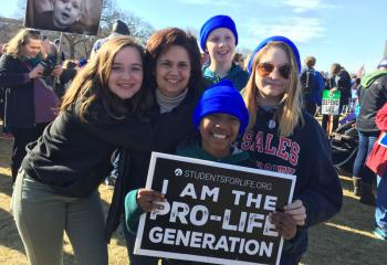 "Declaring ""I Am the Pro-Life Generation"" are members of the Assumption BVM group, from left, Jessica Krafczyk, Jill Krafczyk, Jeremy Sumner, John Paul Krafczyk and Tessa Temple. (Photo courtesy of Lisa Temple)"