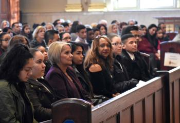 Catechumens listen to the homily during the ceremony that called them to the sacraments at Easter.