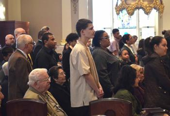 Catechumens stand as their names are called during the Act of Election.