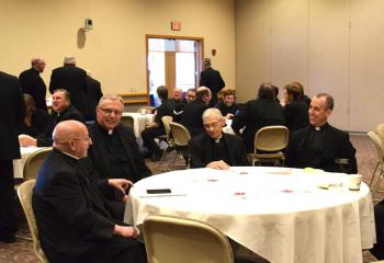 Bishop William Waltersheid, left, chats with, from left: Msgr. Gerald Gobitas, Diocesan chancellor and secretary for clergy; Msgr. Walter Scheaffer, pastor of St. Mary, Kutztown; and Father Michael Mullins, pastor of St. Paul, Allentown.