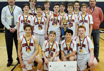St. Thomas More is the grade school boys' champion. From left are: front, Jake Seed, Jacksen Jobes, Patrick Bova and Nate Mullaney; second row, Aidan Wakstein, Ben Scandone, Brendan Boyle, Kyle Hodrick and Michael Driscoll; back, head coach Dave Gehris, Liiam Joyce, Brandon Quinn, Alistair Stewart-Smith, Griff Patridge and coach Kevin Hodrick.