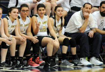 Players and coaches from St. Jane Frances de Chantal, Easton watch game action with St. Thomas More during semi-finals March 4 at St. Joseph the Worker.