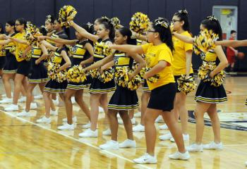 St. Peter's cheerleaders cheer on the guys during the grade school boys' semi-finals March 4.