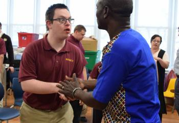 Thomas Awiapo meets James Hebert after talking about his struggle for survival while growing up in a small African village in Ghana. (Photo by John Simitz)