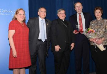 The first-time award for Lifetime Service to the Catholic Charities Gala was presented to Paul and Patty Huck, right, who have served on the gala committee since its inception. At left are this year's chairpersons Evelyn and Anthony Carfagno, and Bishop Schlert.