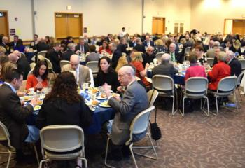 Guests enjoy the festive evening, which garnered $240,000 to help those in need.