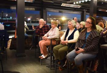 "Adults gather at P.J. Whelihan's Pub and Restaurant, West Lawn for ""Faith and Spirits."""