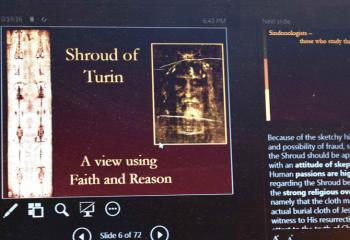 One of the slides during the talk highlights the importance of faith and reason while contemplating the authenticity of the Shroud of Turin.