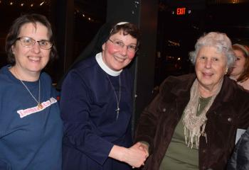 Sister Rose, center, reconnects with her former classmate, Sarah Amidon, parishioner of St. John Neumann, Lancaster, left, and friend, Gerri Frink from St. Ignatius Loyola, Sinking Spring.