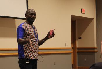 Thomas Awiapo tells how he overcame his struggle for survival thanks to CRS Rice Bowl during a talk Feb. 21 at DeSales University, Center Valley. (Photo courtesy of Robert Olney)