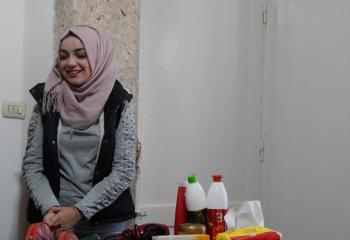 Rahaf Alshawi, a single 21-year-old Syrian woman who was able to start her own hairdressing salon with a grant through the Livelihoods Services Initiative. She supports a family of five – her mother, a father in poor health and two younger brothers.