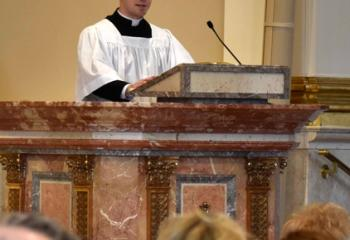 Seminarian Philip Maas offers a reading.