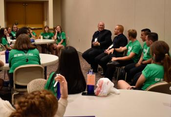 Father Allen Hoffa, center, and Father Mark Searles talk with Fiat Days participants during a question and answer panel discussion so the girls can ask priests and seminarians questions and the boys can ask the sisters questions about their life and vocation.