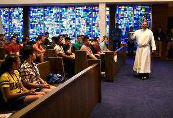 "Father Keith Laskowski presents the talk ""Striving for Integrity"" to boys and girls July 16 in Connolly Chapel."