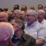 "Men enjoy a laugh at the conference, ""Lord, To Whom Shall We Go?"""