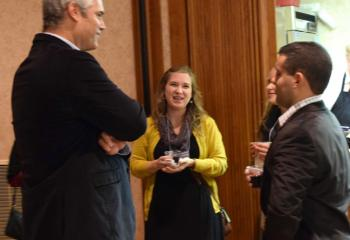 National presenter Bill Donaghy, left, speaks with Jen Shankweiler and Ryan Baptista at the presentation.