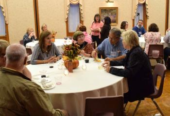 Guests enjoy wine and cheese at the evening sponsored by the Office of Adult Formation.