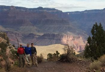 Pausing to take in the vast beauty of the Grand Canyon are, from left, Msgr. Thomas Orsulak, Father John Gibbons and Father Patrick Lamb.