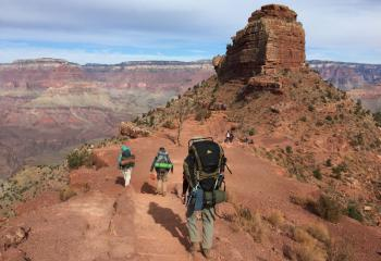 The group hikes the splendor of the Grand Canyon.