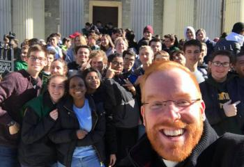 Father Mark Searles, front right, and Allentown Central Catholic High School (ACCHS) students show their pro-life enthusiasm outside the Basilica. (Photo courtesy of Father Mark Searles)