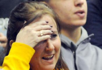 Melanie Markulics watches her son, Richie Markulics, NDHS, wrestle for and win third place 3-2 during the 120-pound bout.