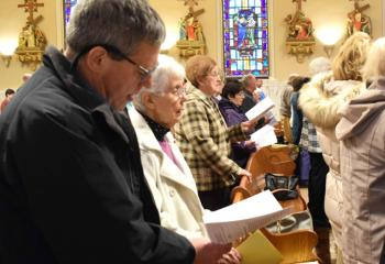 Those gathered lift their voices in song at the evening liturgy.