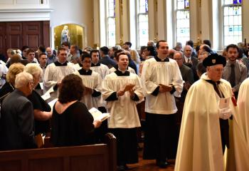 Seminarians and members of the Knights of Columbus process into the Cathedral.