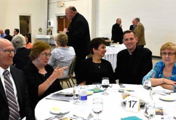Father John Hutta, fourth from left, greets parishioners from Sacred Heart Palmerton, from left, Andy Krawchuk, Bonnie Lagorick, Sandy Miller and Barbara Shelton. (Photo by John Simitz)