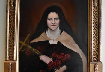 "Armusik's ""St. Therese of the Little Flower"" is also on display at St. Mary. (Photo by John Simitz)"
