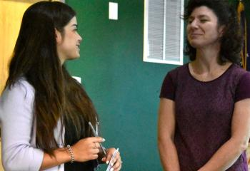 Francesca Frias, assistant coordinator of the Diocesan Office of Youth, Young Adult and Family Ministry (OYYAFM), left, speaks with Kelly Anderson.