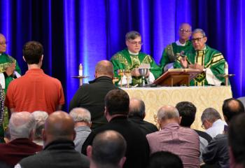 Bishop of Allentown Alfred Schlert, center, celebrates Mass at the Diocesan Men's Conference. From left are: Deacon Hernandez; Deacon Michael Doncsecz, assigned to Queenship of Mary, Northampton; and Bishop Cisneros.