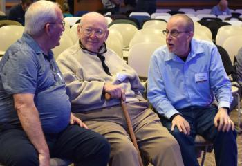 Enjoying conversation during the break are, from left: Frederick Yanity; Jack Huber; and Deacon John Mroz, assigned to St. Joseph, Jim Thorpe.