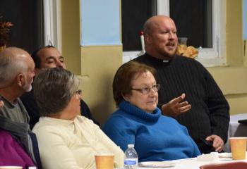 Father Allen Hoffa, pastor of St. Joseph, Summit Hill and rector of the shrine, participates in the discussion.