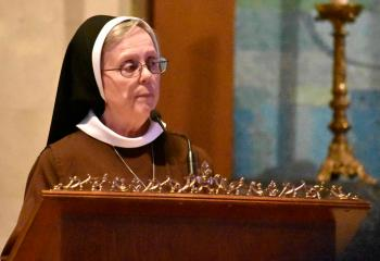 Sister Vincent de Paul serves as lector for the second reading.