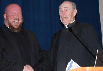 Father Allen Hoffa, left, pastor of St. Joseph, Summit Hill, enjoys a laugh with Monsignor Joseph Smith, gala honoree and pastor emeritus of St. Catharine of Siena, Reading.