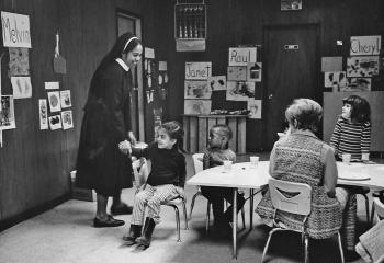Sister Fabian Tucker helps teach English to children in 1970 at Kennedy House, Reading. (Photo courtesy of Kennedy House)