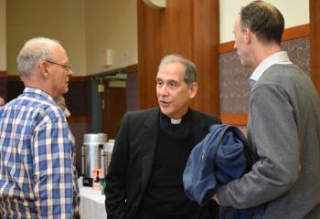 Father Ezaki chats with Roy D'Ginto, left, and Tim Haring.